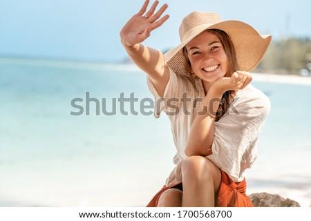 beautiful girl on the beach smiling in white straw hat and bikin stock photo © wavebreak_media