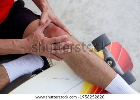 Sport injury - painful knee surfing accident Stock photo © Maridav