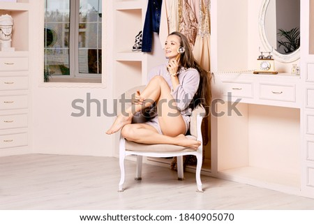 Stock photo: portrait of girl sitting in armchair with an retro phone interi