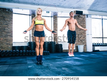 Woman and man skipping rope at the gym Stock photo © sumners
