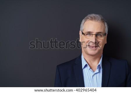 Senior homem amigável sorrir em pé escuro Foto stock © leventegyori