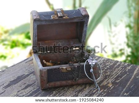 retro wooden box casket with metal parts on white stock photo © kayros