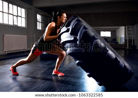 Trainer training woman in lifting kettlebells at fitness studio Stock photo © wavebreak_media