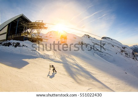 Snowboarder trying to getting at ski lift at top of the mountain Stock photo © DisobeyArt
