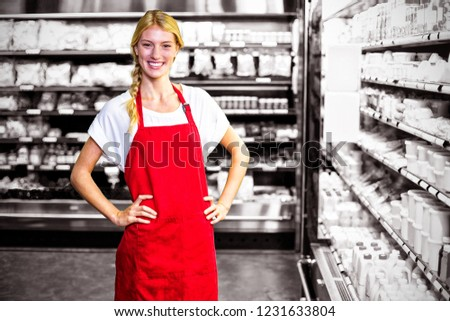 Smiling female staff standing with hand on hip in organic section Stock photo © wavebreak_media