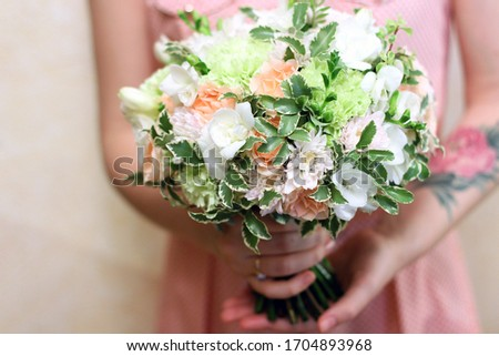 Beautiful bouquet of pink roses in womans hands with tatoo. Top view. Stock photo © artjazz