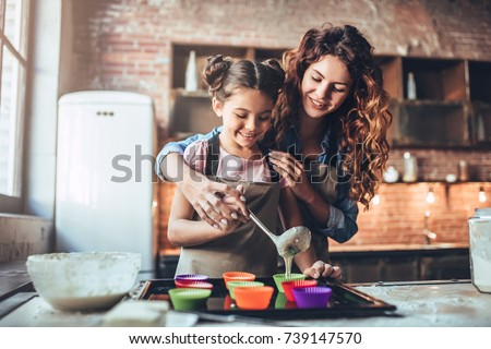 happy young woman and her little cute daughter are having fun in stock photo © dashapetrenko