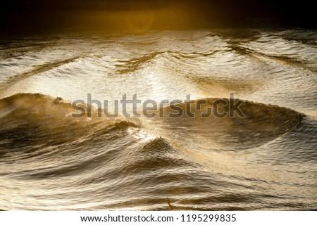 Stock photo: Mascaret, close-up amazing wavy trace on Garonne river at sunset