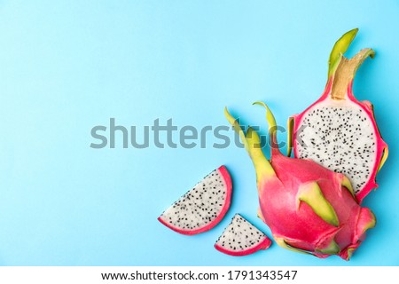 Dragon fruit or pitahaya ripe exotic fruit on a blue background with copy space. Flat lay Stock photo © artjazz