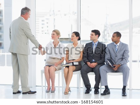 businessmen and businesswoman waiting in line for job interview stock photo © feedough