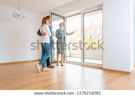 Young couple getting tour through apartment they consider renting Stock photo © Kzenon