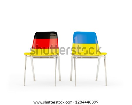 Two chairs with flags of germany and ukraine isolated on white Stock photo © MikhailMishchenko