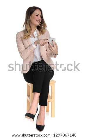 seated businesswoman shows telephone screen and looks to side Stock photo © feedough