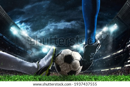 Close up of a football action scene with competing soccer players at the stadium Stock photo © alphaspirit