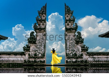 Young woman tourist in Traditional balinese hindu Temple Taman Ayun in Mengwi. Bali, Indonesia Stock photo © galitskaya