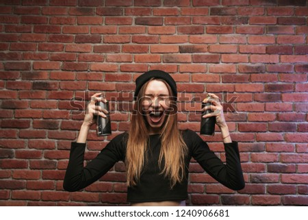Image of excited hip hop girl 20s, standing against brick wall w Stock photo © deandrobot
