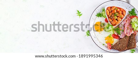 Food on table. Bacon and bread, on a plate with healthy vegetables. Coffee on the table next to a pl Stock photo © makyzz