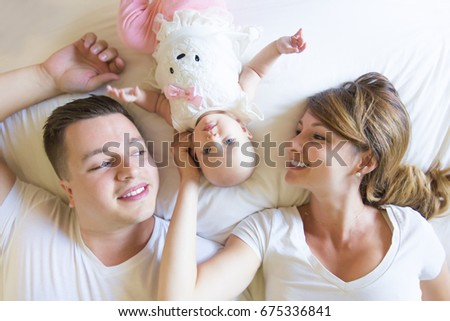 Portrait of father with her 3 month old baby in bedroom sleeping Stock photo © Lopolo