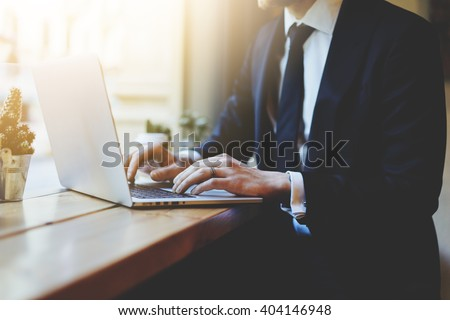 Male hands using laptop in modern coffee shop or loft, professio Stock photo © Freedomz
