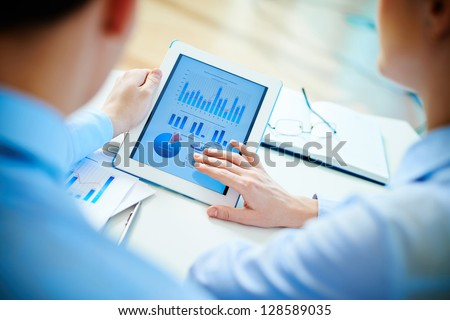 Businesswoman working tablet, the charts and graphs showing the  Stock photo © Freedomz