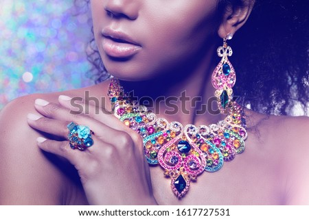 Beautiful girl with set jewelry. Woman in a necklace with a ring, earrings, crown. Accessories. Fash stock photo © serdechny