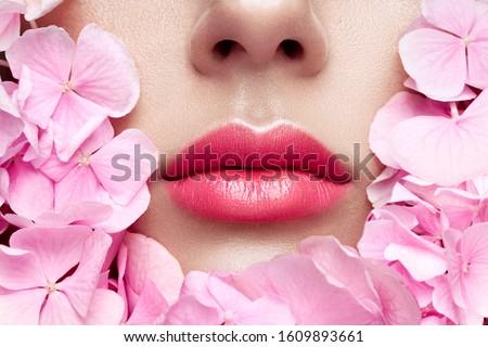 Beautiful closeup with female plump lips with gold color makeup. Fashion celebrate make-up, glitter  stock photo © serdechny