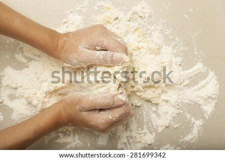 Stock photo: female housewife making homemade pasta with flour and eggs over