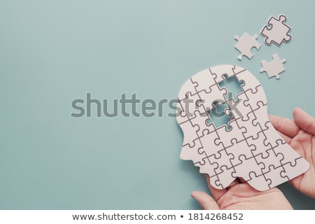 Hands Holding Paper With Cutout Brain Stock photo © AndreyPopov
