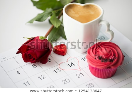Stock photo: close up of calendar, coffee, cupcake and red rose