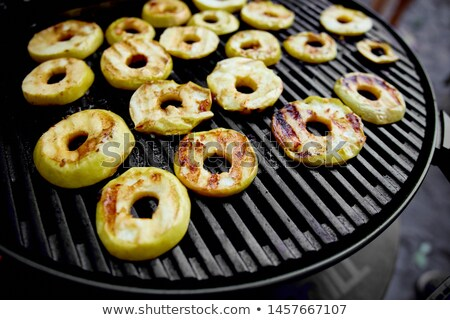 Grilled apples on black gas grill. Grilled dessert.  Stock photo © Illia
