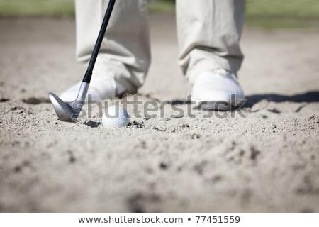 Macro of golfer in bunker. Stock photo © lichtmeister