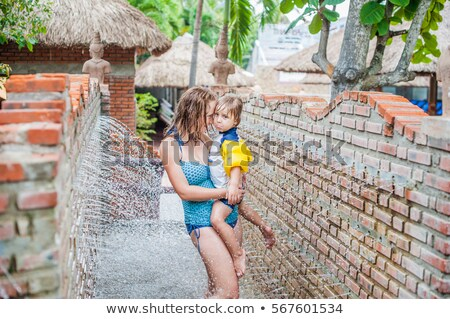 mother and son in the massage shower from the wall stock photo © galitskaya