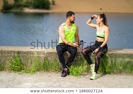 Mooie brunette atleet opleiding pauze sensueel Stockfoto © majdansky