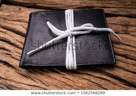 Noir cuir portefeuille dentelle bois Photo stock © AndreyPopov
