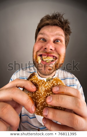 Man chewing hamburger Stock photo © nomadsoul1