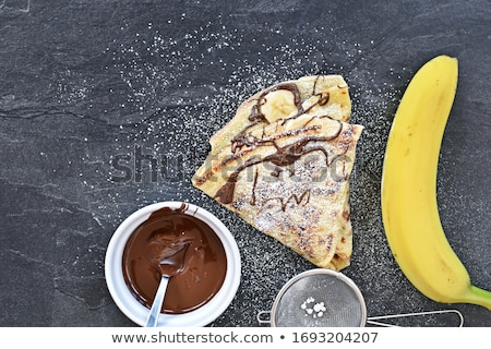 Freshly prepared crepes with banana & chocolate sauce Stock photo © danielgilbey