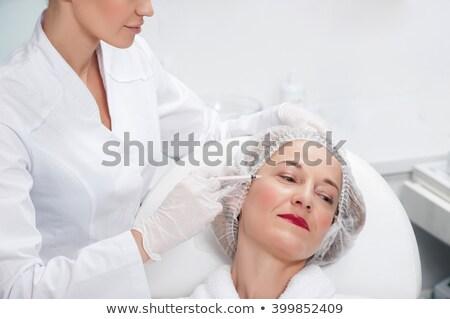 старший женщину стороны шприц красоту пластическая хирургия Сток-фото © dolgachov