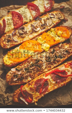 Composition of hot tasty baked sandwiches with various toppings. Cheese, tuna, mozarella, spices Stock photo © dash