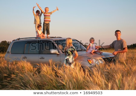 Parents and children on offroad car on wheaten field Stock photo © Paha_L