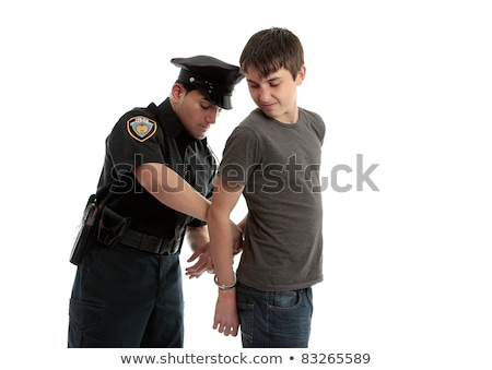 policeman arresting teen criminal stock photo © lovleah