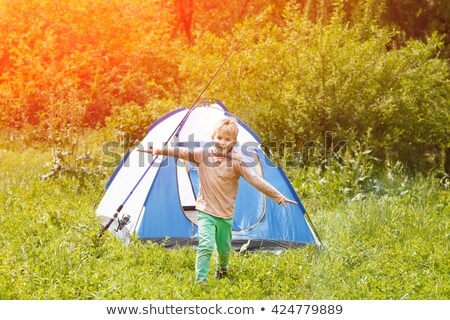 happy boys jumping near camping tent Stock photo © Mikko