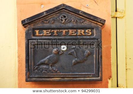 Old ancient mail box on wall Stock photo © dundanim