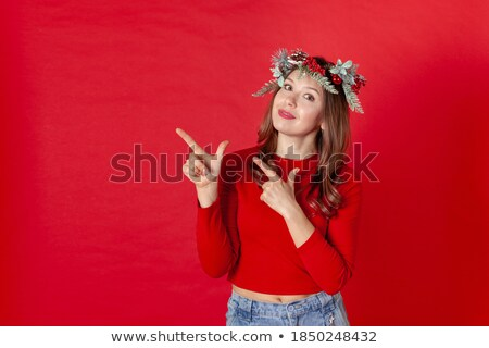 woman pointing with her fingers to the present on her head stock photo © Rob_Stark