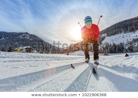 Cross-country skiing: young man cross-country skiing Stock photo © lightpoet