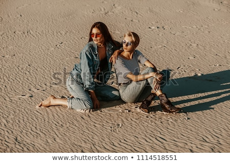 cowboy boots and denim shorts 2 stock photo © dolgachov