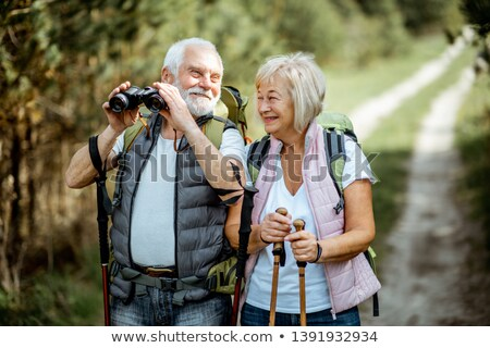 Old man with binoculars Stock photo © photography33