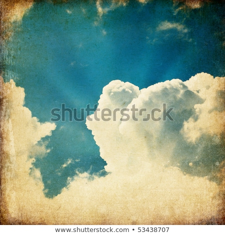clouds and a blue sky with a sun rays shining through useful as stock photo © pashabo
