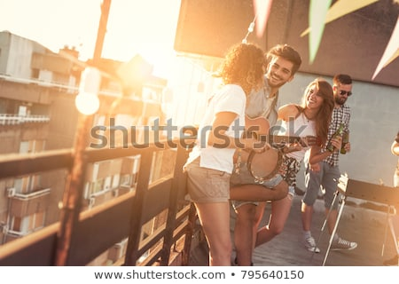 Stock photo: Young people enjoying a summer barbecue on the terrace