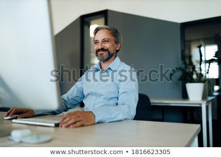 Stock photo: senior man doing computer outside