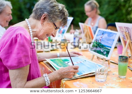 senior woman painting at home Stock photo © photography33